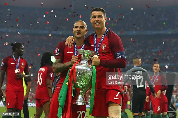 Cristiano Ronaldo and Ricardo Quaresma and Portugal pose for photographs with the Henri Delaunay trophy to celebrate after their 1-0 win against...