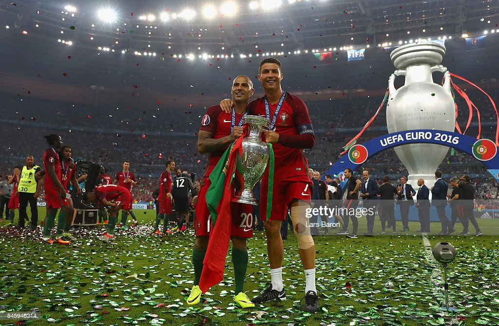 Cristiano Ronaldo (R) and Ricardo Quaresma (L) and Portugal pose for photographs with the Henri Delaunay trophy to celebrate after their 1-0 win against France in the UEFA EURO 2016 Final match between Portugal and France at Stade de France on July 10, 2016 in Paris, France.