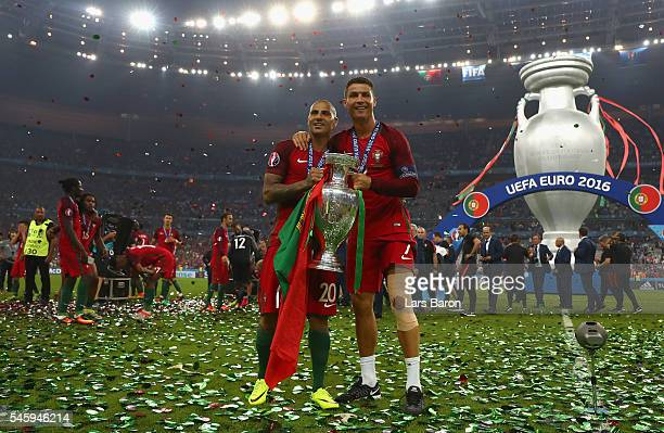 Cristiano Ronaldo and Ricardo Quaresma and Portugal pose for photographs with the Henri Delaunay trophy to celebrate after their 10 win against...