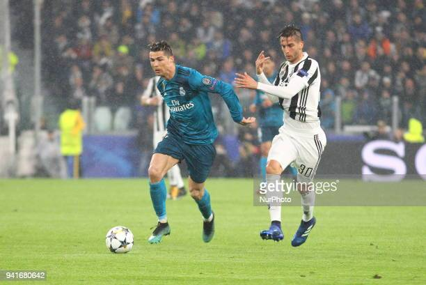 Cristiano Ronaldo and Rodrigo Bentancur competes for the ball during the first leg of the quarter finals of the UEFA Champions League 2017/18 between...