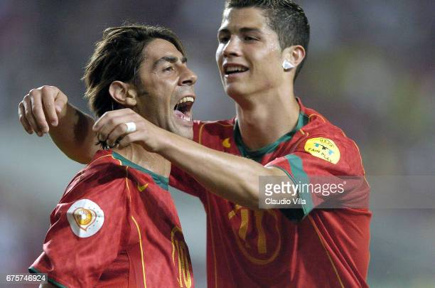 Cristiano Ronaldo and Rui Costa of Portugal celebrate during the UEFA Euro 2004 match between Portugal and Russia on June 16 2004 in Lisbon Portugal