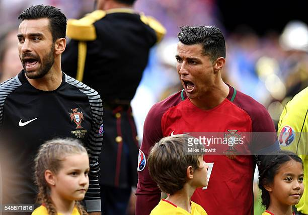 Cristiano Ronaldo and Rui Patricio of Portugal sing the national anthem prior to the UEFA EURO 2016 Final match between Portugal and France at Stade...