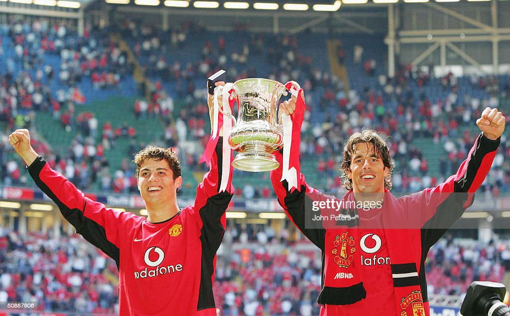 Cristiano Ronaldo and Ruud van Nistelrooy of Manchester United celebrate with the FA Cup after winning the AXA FA Cup Final between Manchester United and Millwall at the Millennium Stadium on May 22, 2004 in Cardiff, Wales.