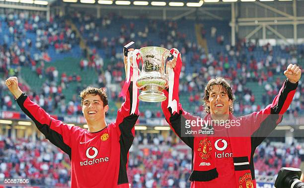 Cristiano Ronaldo and Ruud van Nistelrooy of Manchester United celebrate with the FA Cup after winning the AXA FA Cup Final between Manchester United...