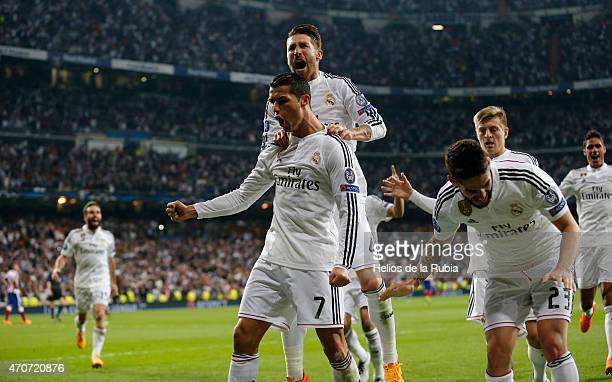 Cristiano Ronaldo and Sergio Ramos of Real Madrid celebrate after scoring during the UEFA Champions League Quarter Final second leg match between...