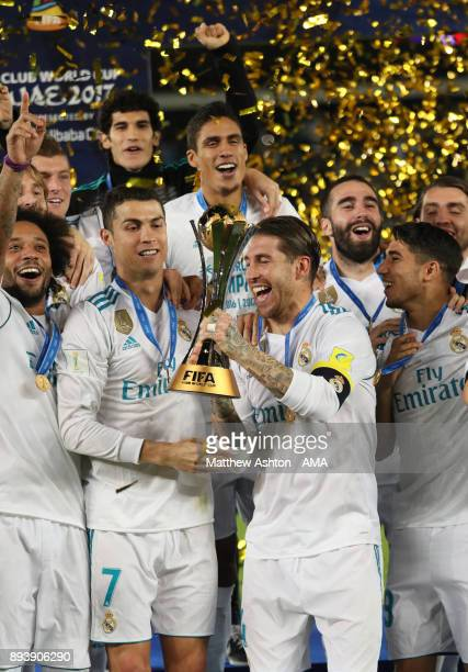Cristiano Ronaldo and Sergio Ramos of Real Madrid lift the trophy with their teammates at the end of the FIFA Club World Cup UAE 2017 final match...