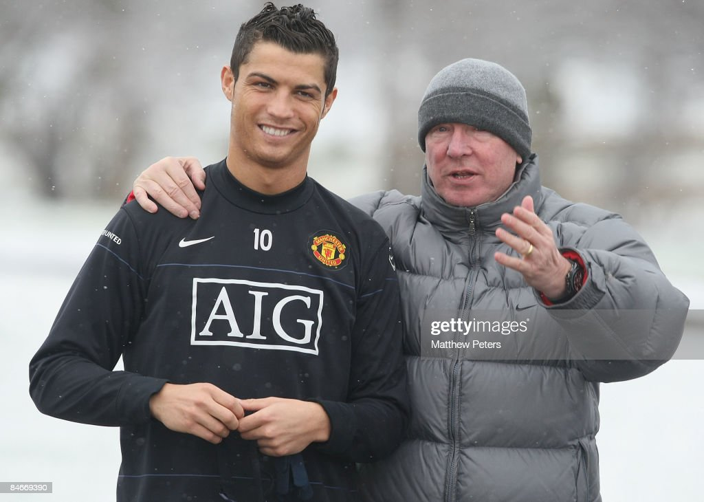Cristiano Ronaldo and Sir Alex Ferguson of Manchester United in action during a first team training session at Carrington Training Ground on February 6, 2009 in Manchester, England.