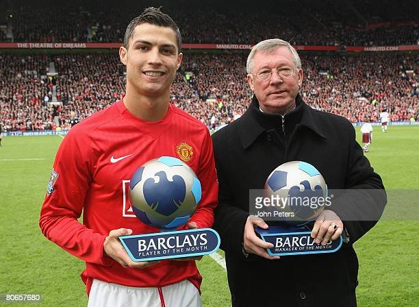 Cristiano Ronaldo and Sir Alex Ferguson of Manchester United pose with their Barclays Player and Manager of the Month awards ahead of the Barclays FA...