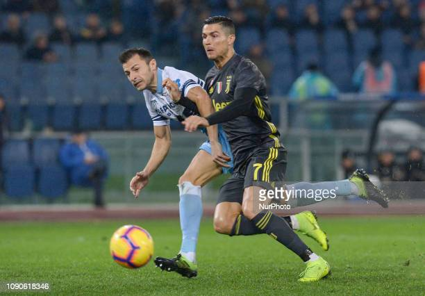 Cristiano Ronaldo and Stefan Radu during the Italian Serie A football match between SS Lazio and FC Juventus at the Olympic Stadium in Rome on...