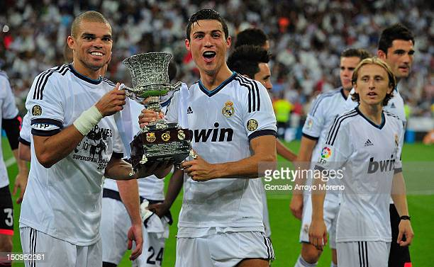 Cristiano Ronaldo and teammate Pepe of Real Madrid celebrates with the trophy after winning the Supercopa at the end of the Supercopa second leg...