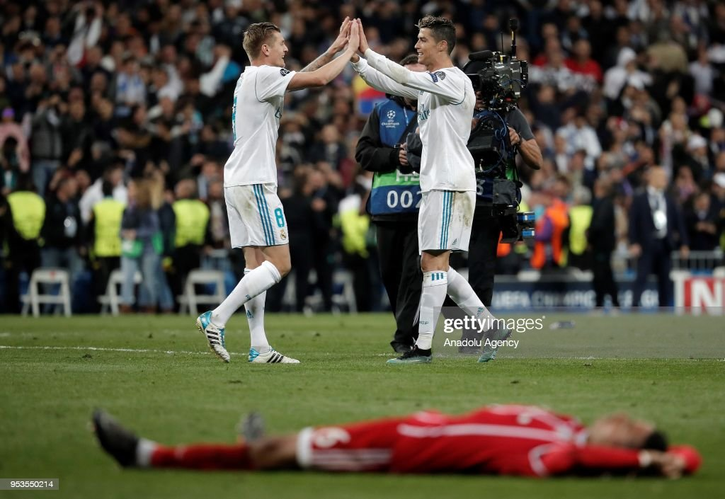 Cristiano Ronaldo (R) and Toni Kroos (L) of Real Madrid celebrate their victory at the end of the UEFA Champions League semi final second leg match between Real Madrid and FC Bayern Munich at the Santiago Bernabeu Stadium in Madrid, Spain on May 1, 2018.