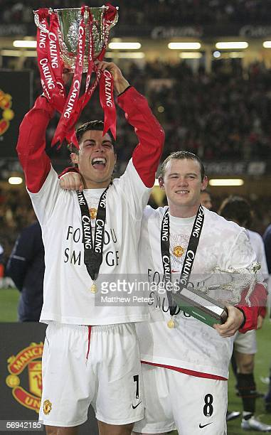 Cristiano Ronaldo and Wayne Rooney of Manchester United pose with the Carling Cup trophy after the Carling Cup Final match between Manchester United...