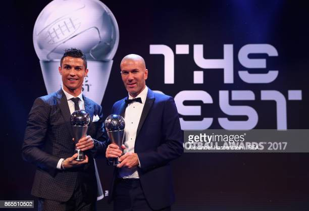 Cristiano Ronaldo and Zinedine Zidane pose for a photo accepts The Best FIFA Men's Player award during The Best FIFA Football Awards at The London...
