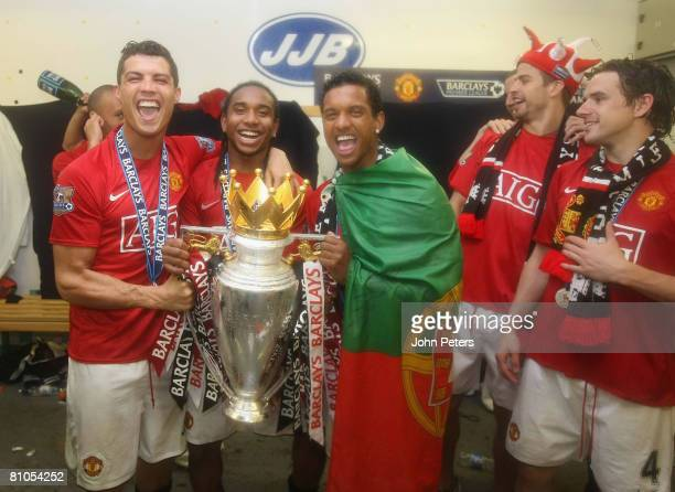Cristiano Ronaldo Anderson and Nani of Manchester United celebrate with the Premier League trophy in the dressing room afetr the Barclays FA Premier...
