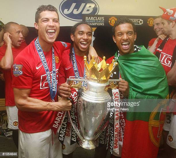 Cristiano Ronaldo Anderson and Nani of Manchester United celebrate with the Premiership trophy after the Barclays FA Premier League match between...