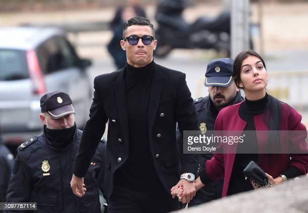 Cristiano Ronaldo arrives with girlfriend Georgina Rodriguez at the Audiencia Provincial de Madrid court on January 22 2019 in Madrid Spain The...