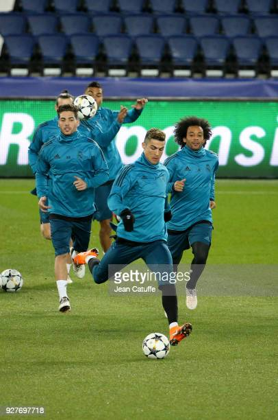 Cristiano Ronaldo between Luca Zidane and Marcelo Vieira da Silva of Real Madrid during Real Madrid's training on the eve of UEFA Champions League...