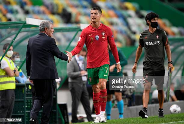 Cristiano Ronaldo, Captain of Portugal shakes hands with Fernando Santos, Manager of Portugal after being substituted during the international...
