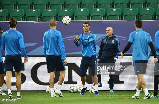 Cristiano Ronaldo catches the ball during a Real Madrid training session ahead of their UEFA Champions League quarter final first leg match against...