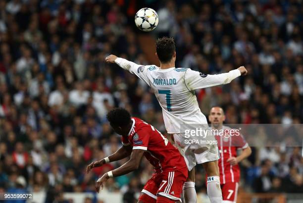 Cristiano Ronaldo competes for the ball with David Alaba during the UEFA Champions League Semi Final Second Leg match between Real Madrid and Bayern...