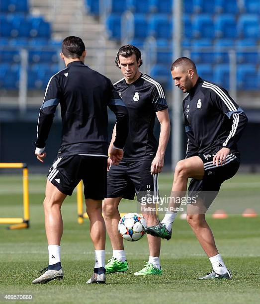Cristiano Ronaldo Gareth Bale and Karim Benzema of Real Madrid warm up during a training session at Valdebebas training ground on April 13 2015 in...
