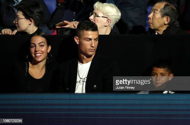 Cristiano Ronaldo his girlfriend Georgina Rodríguez and son Cristiano Ronaldo Jr watch on during the singles round robin match between Novak Djokovic...