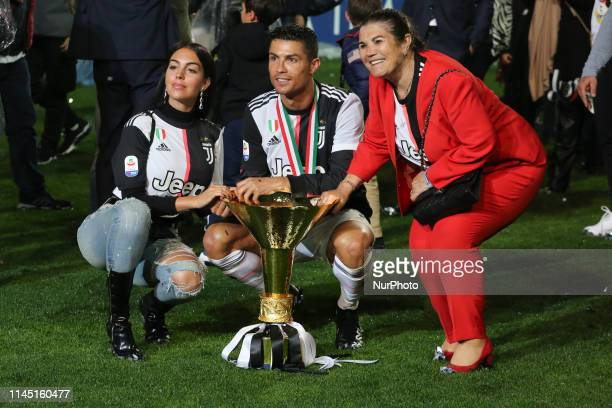 Cristiano Ronaldo his mather Maria Dolores dos Santos Aveiro and Georgina Rodriguez with the trophy of Scudetto during the victory ceremony following...