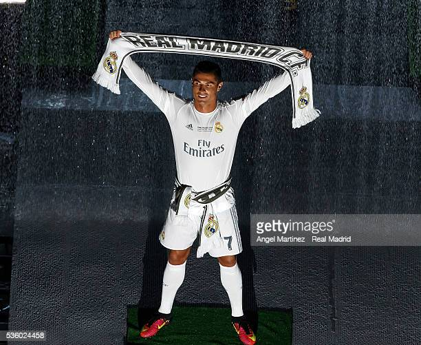 Cristiano Ronaldo holds a scarf during Real Madrid CF team celebration at Santiago Bernabeu Stadium the day after winning the UEFA Champions League...