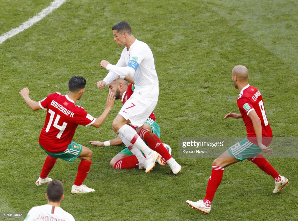 cristiano ronaldo is marked by morocco players during the second