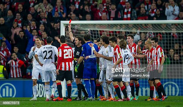 Cristiano Ronaldo is shown a red card during the La Liga match between Athletic Club and Real Madrid CF at San Mames Stadium on February 2 2014 in...