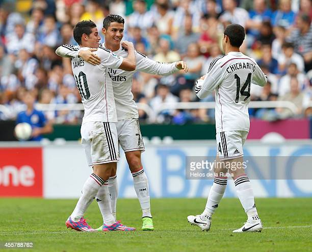 Cristiano Ronaldo James Rodriguez and Chicharito of Real Madrid celebrate after scoring during the La Liga match between RC Deportivo La Coruna and...