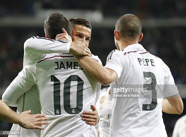 Cristiano Ronaldo James Rodriguez and Pepe of Real Madrid celebrate after scoring during the La Liga match between Real Madrid CF and Malaga at...