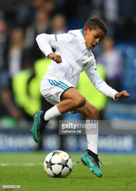 Cristiano Ronaldo Jr shows off his skills after the UEFA Champions League Semi Final Second Leg match between Real Madrid and Bayern Muenchen at the...