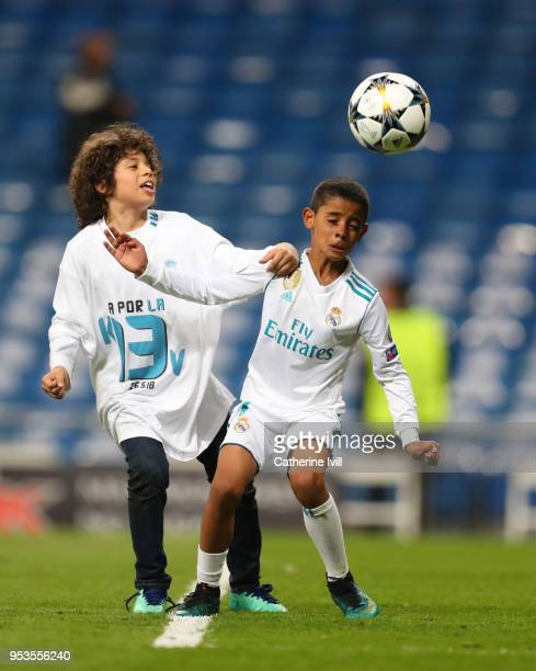 Cristiano Ronaldo Jr shows off his skills with Enzo Gattuso Alves Vieira the son of Marcelo after the UEFA Champions League Semi Final Second Leg...