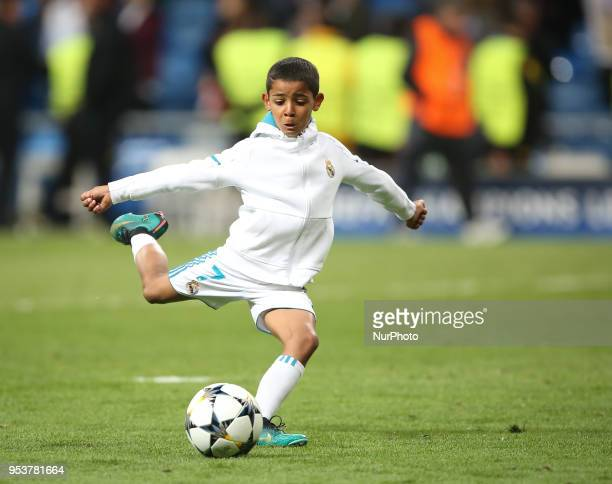 Cristiano Ronaldo Jr son of Cristiano Ronaldo of Real Madrid plays with a ball prior the UEFA Champions League semi final 2nd leg football match...