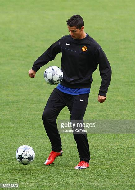 Cristiano Ronaldo juggles two balls during the Manchester United Training Session prior to their UEFA Champions League Quarter Final second leg match...
