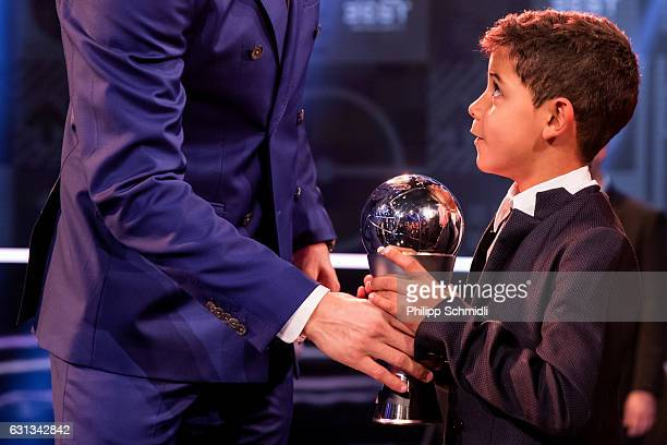 Cristiano Ronaldo Junior receives The Best FIFA Men's Player Award from his father Cristiano Ronaldo of Portugal and Real Madrid after The Best FIFA...