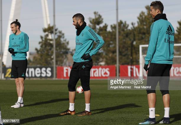 Cristiano Ronaldo Karim Benzema and Gareth Bale of Real Madrid look on during a training session at Valdebebas training ground on January 23 2018 in...