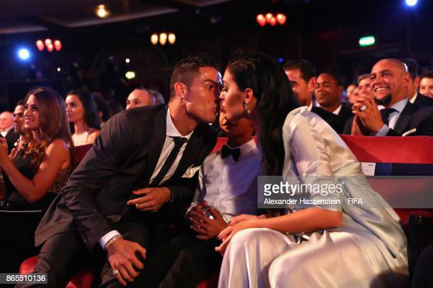 Cristiano Ronaldo kisses girlfriend Georgina Rodríguez after being announced the winner of The Best FIFA Men's Player award during The Best FIFA...