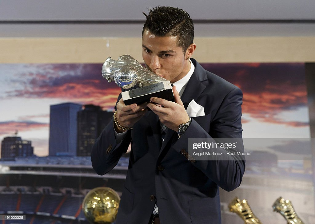 Cristiano Ronaldo kisses his trophy as all-time top scorer of of Real Madrid CF at Honour box-seat of Santiago Bernabeu Stadium on October 2, 2015 in Madrid, Spain. Portuguese player Cristiano Ronaldo overtook Raul's goal scoring record on his last UEFA Champions League match against Malmo FF to become Real Madrid's all-time top scorer.