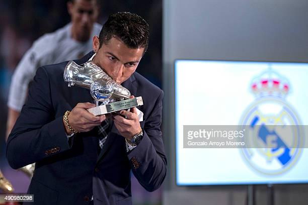 Cristiano Ronaldo kisses his trophy as alltime top scorer of Real Madrid CF at Honour boxseat of Santiago Bernabeu Stadium on October 2 2015 in...