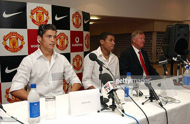 Cristiano Ronaldo Kleberson and Sir Alex Ferguson during the Press Conference at the players official signing at Old Trafford on August 13 2003 in...
