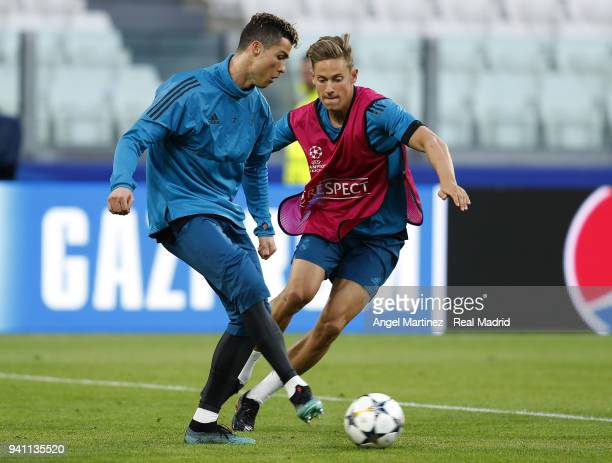 Cristiano Ronaldo L and Marcos Llorente of Real Madrid in action during a training session at Juventus Stadium on April 2 2018 in Turin Italy