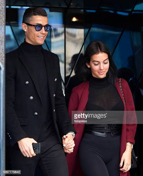Cristiano Ronaldo leaves with his girlfriend Georgina Rodriguez after attending a court hearing for tax evasion at Audiencia Provincial on January 22...