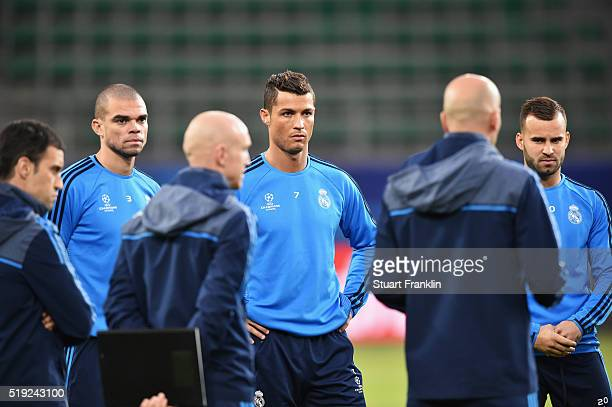 Cristiano Ronaldo looks on during a Real Madrid training session ahead of their UEFA Champions League quarter final first leg match against Wolfsburg...