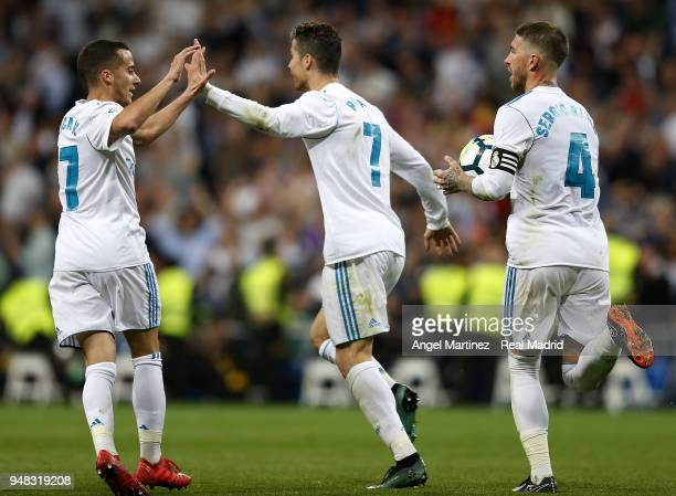 Cristiano Ronaldo Lucas Vazquez and Sergio Ramos of Real Madrid celebrate their equalising goal during the La Liga match between Real Madrid and...