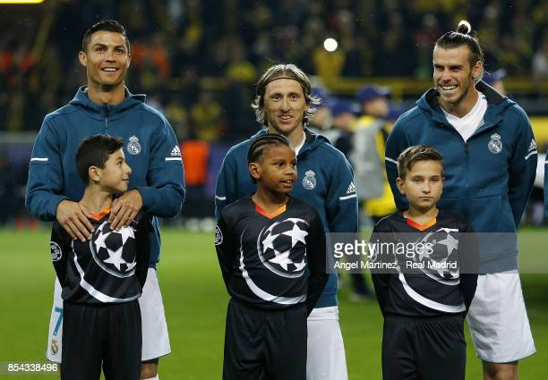 Cristiano Ronaldo Luka Modric and Gareth Bale of Real Madrid look on before the UEFA Champions League group H match between Borussia Dortmund and...