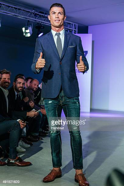 Cristiano Ronaldo makes his catwalk debut to model new styles at the global launch of his FW15 CR7 Footwear collection on October 5, 2015 in...