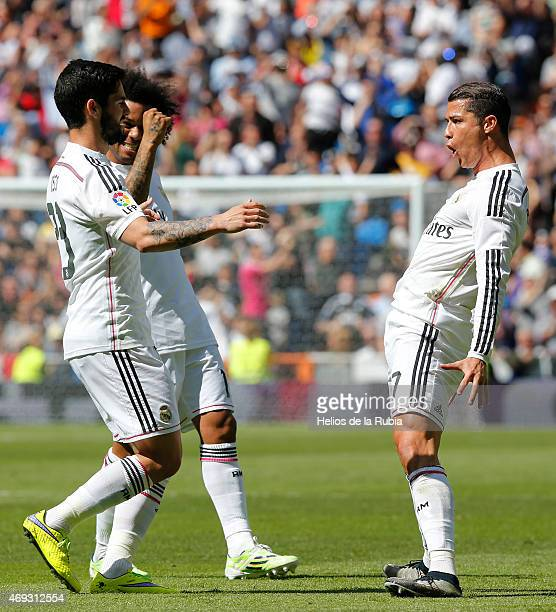 Cristiano Ronaldo Marcelo and Isco of Real Madrid celebrate after scoring during the La Liga match between Real Madrid CF and Eibar at Estadio...