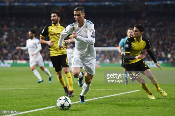 Cristiano Ronaldo of eal Madrid is challenged by Marc Bartra of Borussia Dortmund during the UEFA Champions League group H match between Real Madrid...